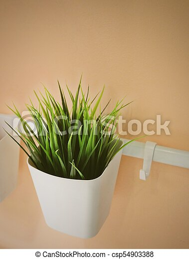 Green Artificial Plant in A White Pot - csp54903388