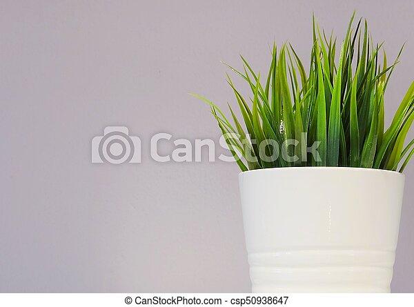 Green Artificial Plant in White Porcelain Pot - csp50938647