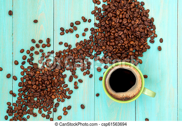 Green cup of coffee and coffee beans - csp61563694