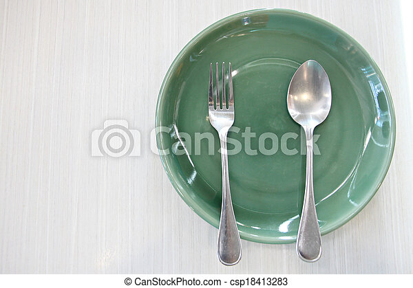 Green Dish and spoon. - csp18413283