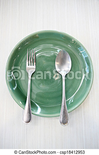 Green Dish and spoon. - csp18412953