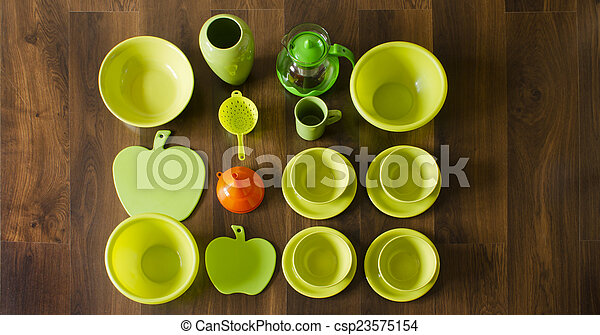 green dishes top view with an orang - csp23575154