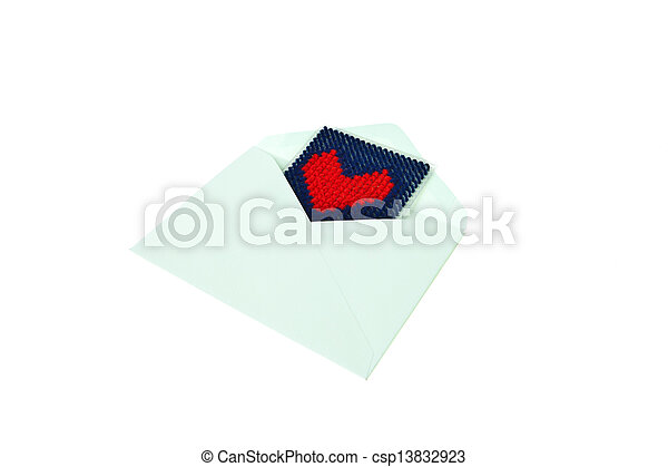 Green envelop with red knitted heart isolated on white background - csp13832923