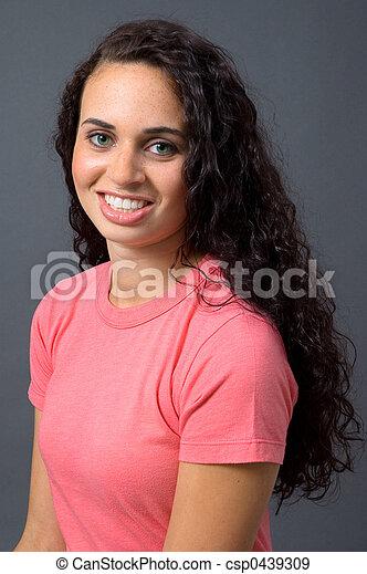 Green-Eyed Woman in Pink tee shirt - csp0439309