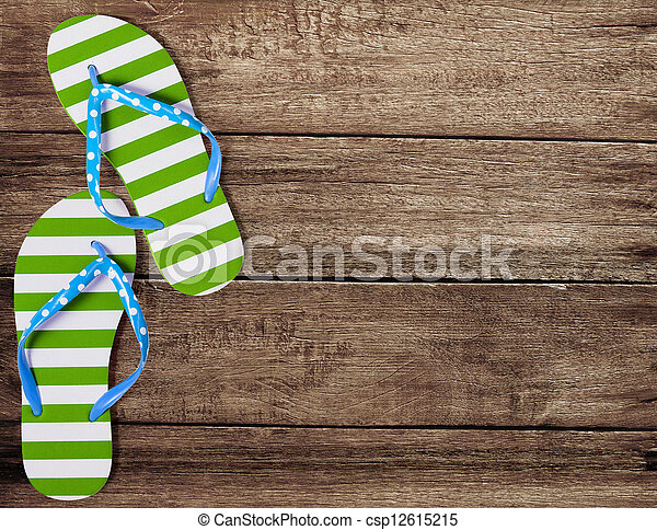 Green flip flop sandals on old wooden boards - csp12615215
