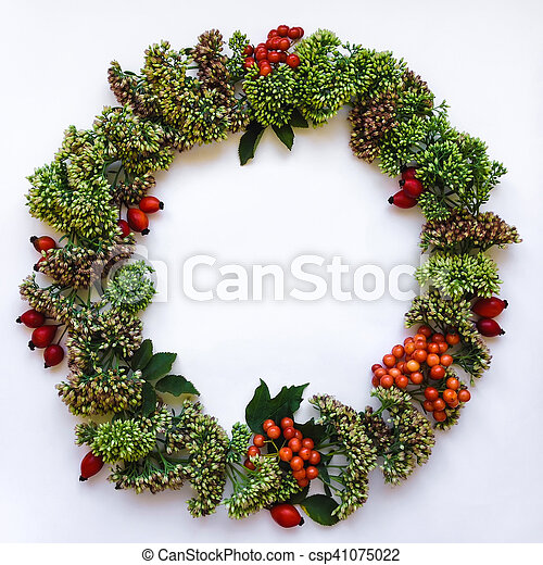 Green floral round wreath frame on white background. Flat lay, top view, view from above. Autumn or winter decoration - csp41075022