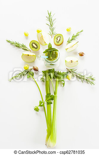 Green flower of vegetables and fruits around a glass of smoothies - csp62781035