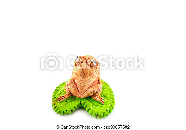 Green frog toy on white - csp30657582