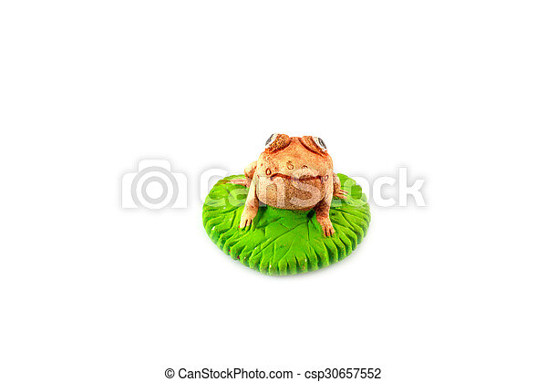 Green frog toy on white - csp30657552