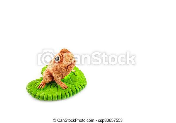 Green frog toy on white - csp30657553