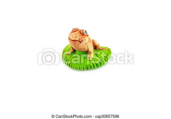 Green frog toy on white - csp30657596