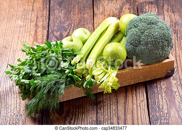 green fruit and vegetables in a wooden box - csp34833477
