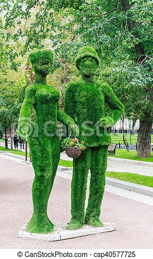 "Green giants family on Tverskoy Boulevard. Festival ""Moscow Seasons"". Moscow - csp40577725"