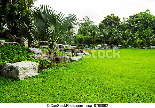 green grass field in park - csp18760882
