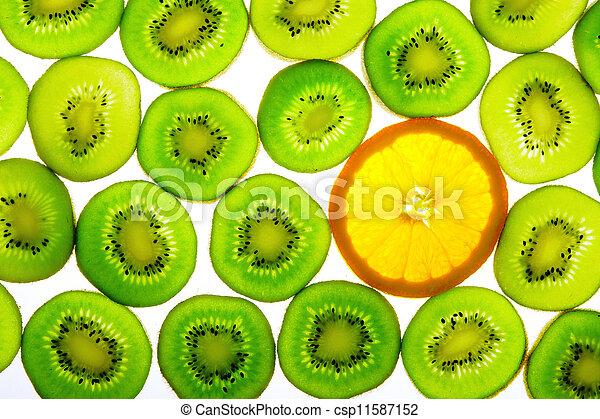 Green kiwi with one orange slice - csp11587152