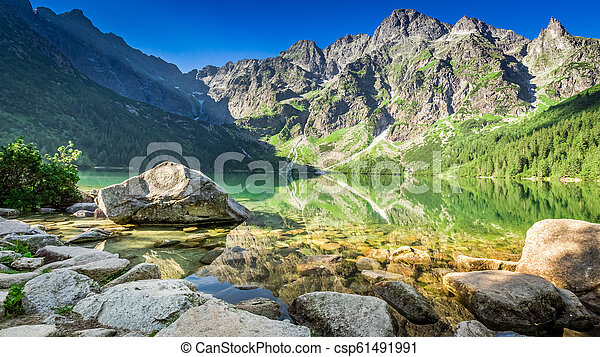Green lake in the mountains at sunrise, Poland - csp61491991
