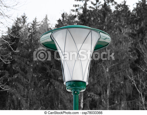 Green lantern in front of a forest - csp78033366