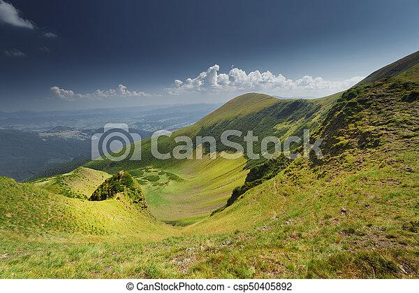 Green meadow in mountain - csp50405892