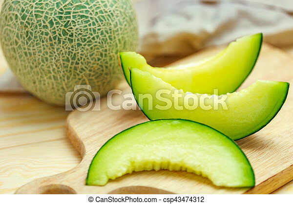 Fresh Sweet Green Melon On The Wooden Table Canstock Organic wheat grass and 7 super greens powder, 2 servings of fruits & veggies per scoop, berry flavor, 30 servings. https www canstockphoto com green melon 43474312 html