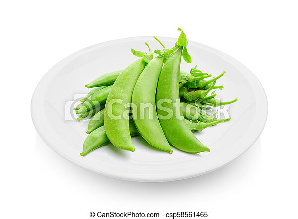 green peas in a plate on white background - csp58561465