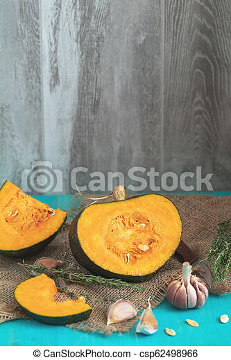 Green Pumpkin and ingredients for tasty vegetarian cooking - csp62498966