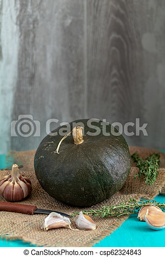 Green Pumpkin and ingredients for tasty vegetarian cooking - csp62324843