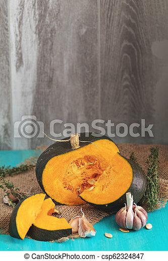 Green Pumpkin and ingredients for tasty vegetarian cooking - csp62324847