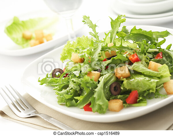 green salad with restaurant setting - csp1516489