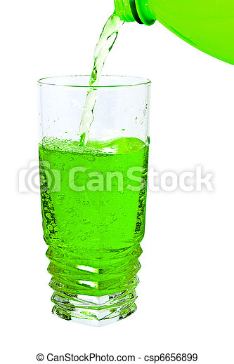 green soda in a tall glass, pour from the bottle - csp6656899
