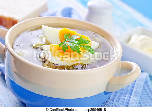 green soup with boiled eggs - csp39046518