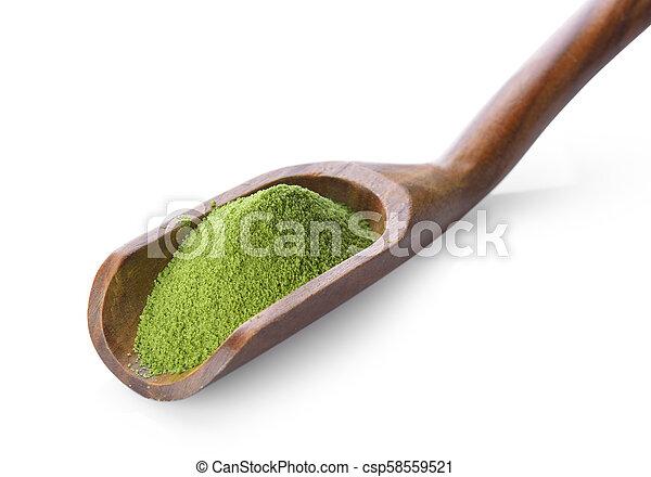 green tea powder in spoon on white background - csp58559521