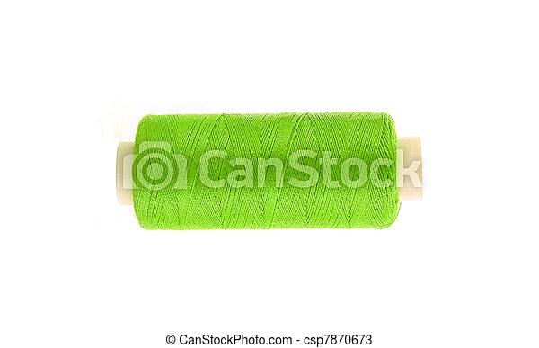 green thread bobbin isolated on white background - csp7870673
