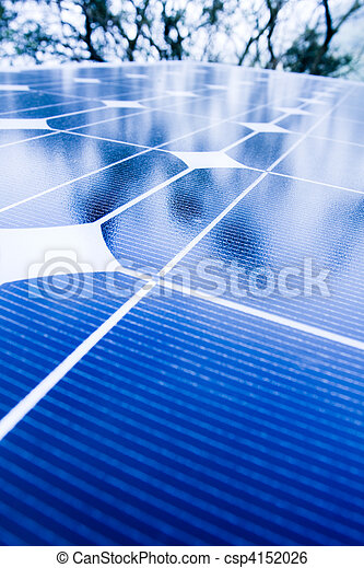 Green trees and blue sky reflection on solar panels. Go green with renewable energy! - csp4152026