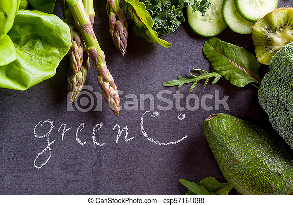 Green vegetables on black slate with inscription word green. - csp57161098
