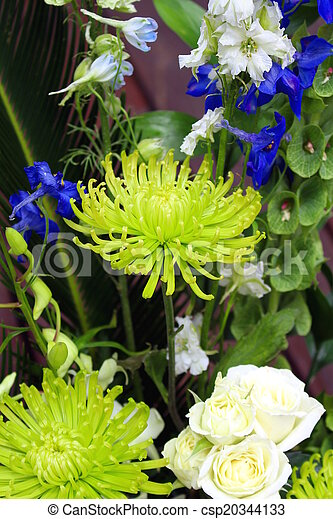 Green White And Blue Flower Arrangement With A Greeting Card