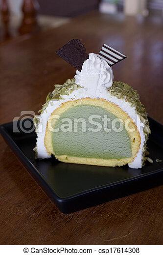 greentea icecream cake on wood table piece of icecream cake on wood