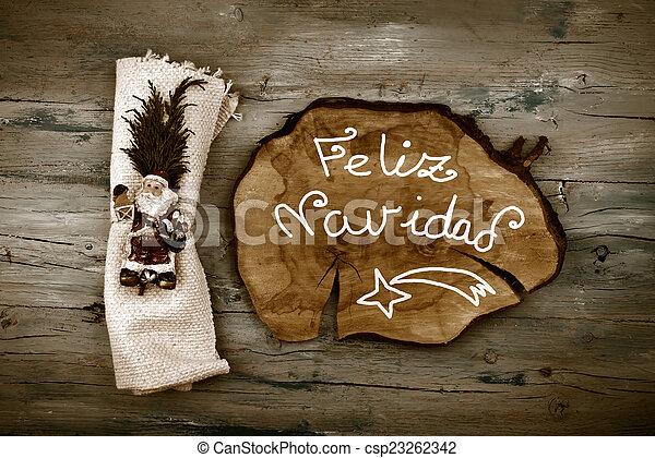 Greeting Christmas Santa in spanish language - csp23262342