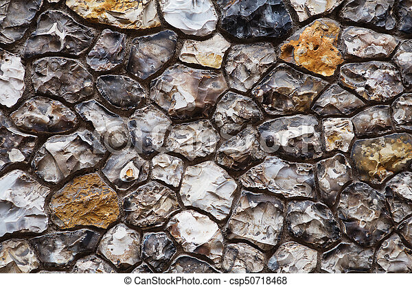 Grey and brown grunge stone wall background - csp50718468