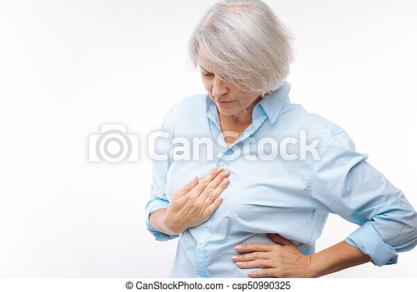 Grey-haired woman suffering from stomachache - csp50990325