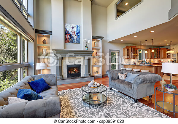 Grey interior of high vaulted ceiling family room.