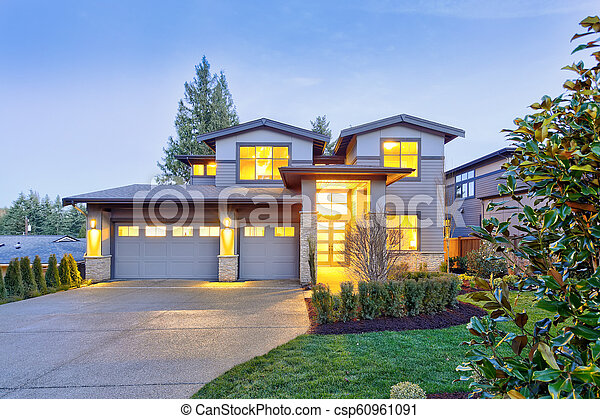 Grey luxury modern two story tall house exterior with stone columns - csp60961091