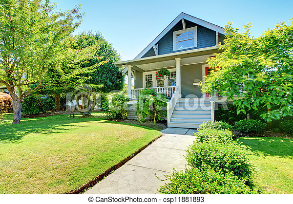 Grey small old American house front exterior with white staircase. - csp11881893