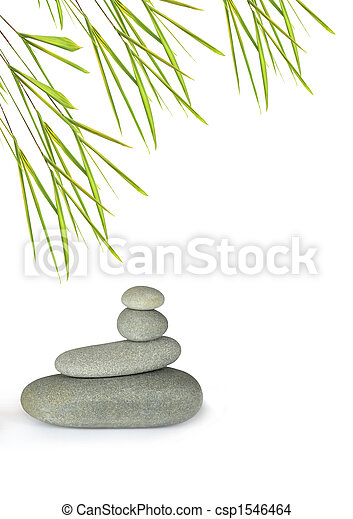 Grey spa treatment stones in perfect balance with bamboo leaf grass, over white background. - csp1546464