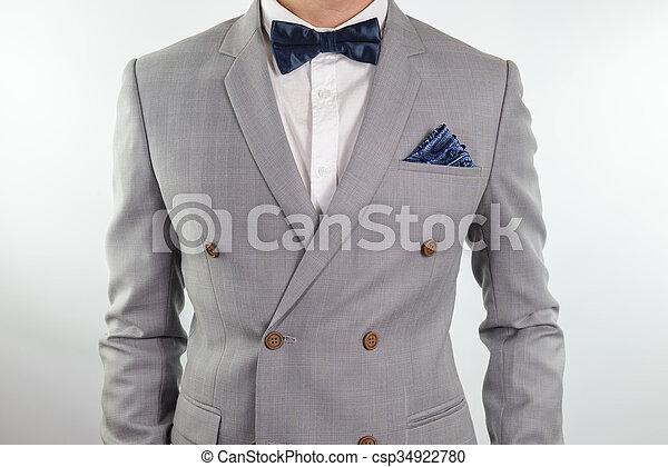 8fd3020d8e2a Grey suit plaid texture, bowtie, pocket square. Man in grey suit ...