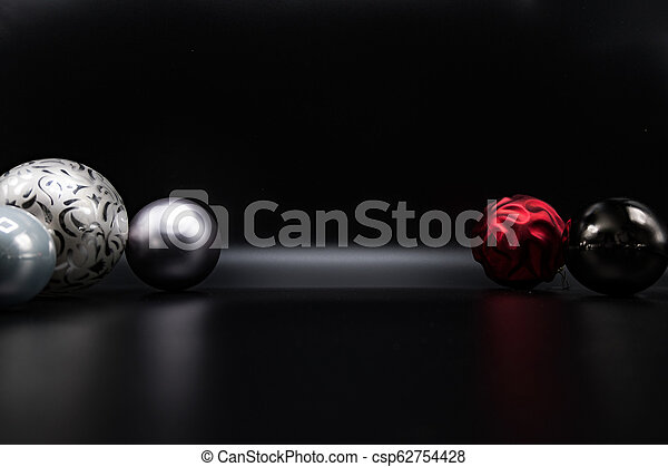 greyscale and red christmas balls on stock photo csp62754428