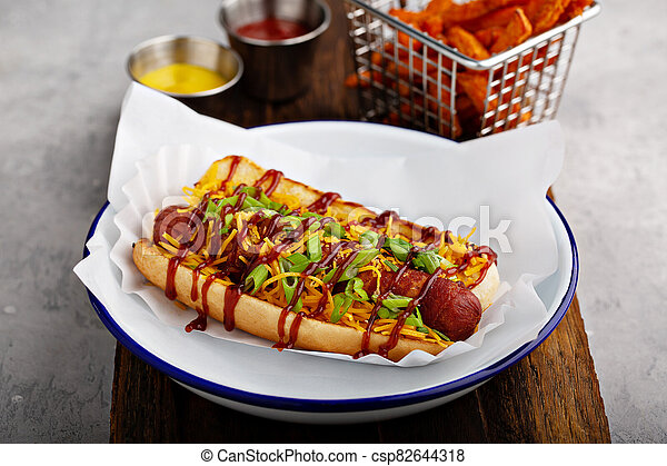 Grilled bacon wrapped hot dog - csp82644318