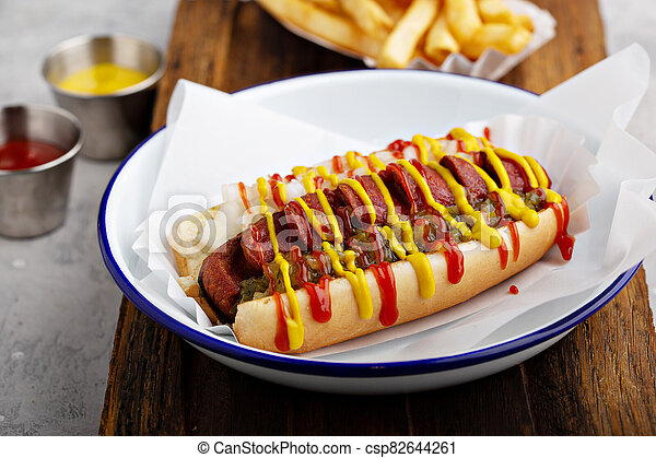 Grilled bacon wrapped hot dog - csp82644261