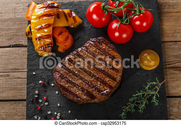 grilled beef steak with vegetables  - csp32953175