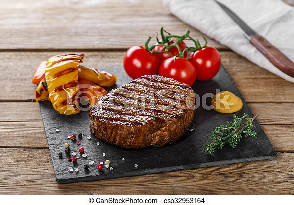 grilled beef steak with vegetables  - csp32953164