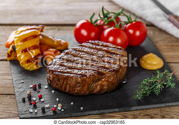 grilled beef steak with vegetables  - csp32953165